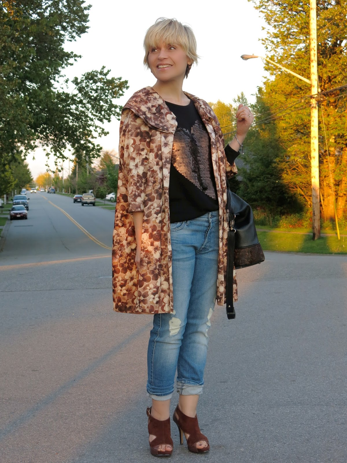 styling a vintage coat with a sequinned sweater and boyfriend jeans