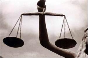 Crítica. Justiça identifica mal os réus em processo.