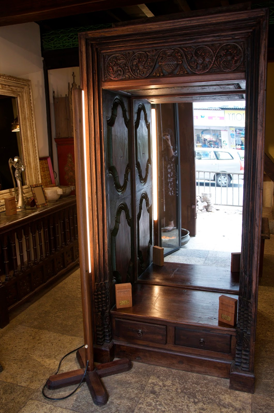 It was hard to take a good picture of this without getting myself in the  frame! It's a vanity mirror console framed with old Victorian, carved Burma  teak ... - BombayJules: Pondicherry (Mumbai) - New Antiques & Interiors Find!