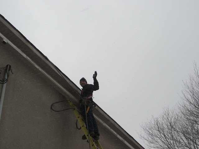 Eavestrough installation in winter Toronto gutter Scarborough