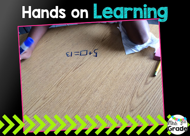 Hands on learning - writing on a small group table