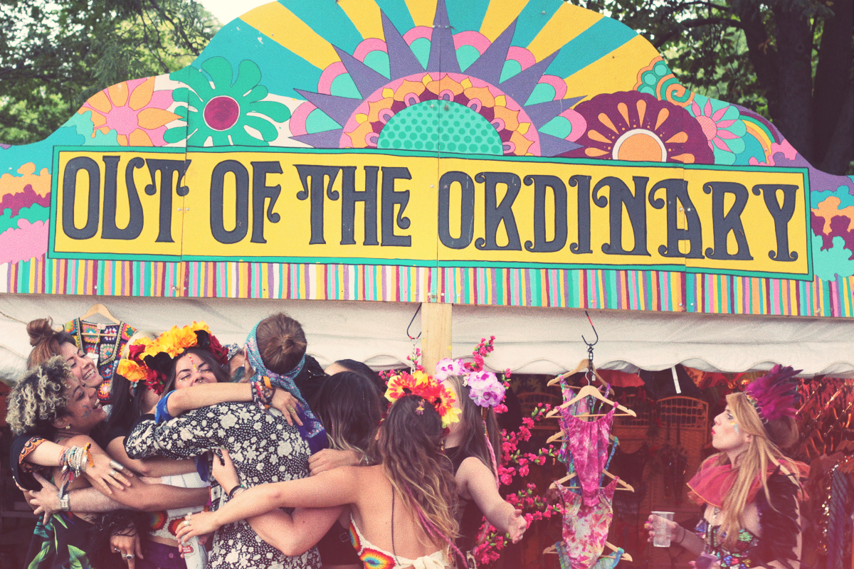 out of the ordinary, lovebox, festival, 70's, hippies, festival signage, stall