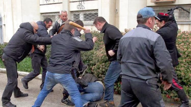 http://news.yahoo.com/photos/pro-russian-self-defence-activists-bat-whip-beat-photo-145207242.html