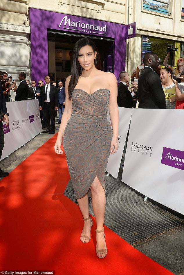 Kim Kardashian sizzles in semi sheer bandeau dress in Paris