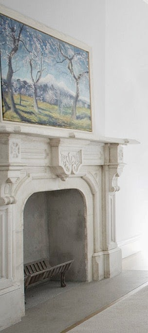 Classical fireplace and paiting