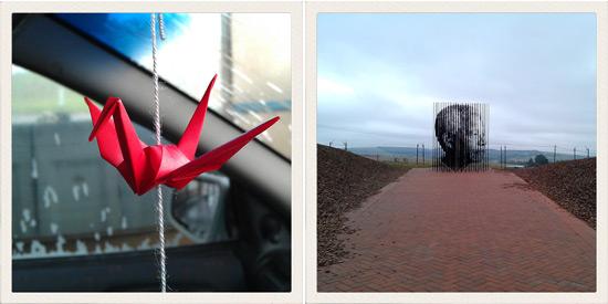 An origami paper crane and the Nelson Mandela monument in KZN