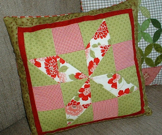 http://www.craftsy.com/pattern/quilting/home-decor/shooting-star-cushion-pillow-top/65112