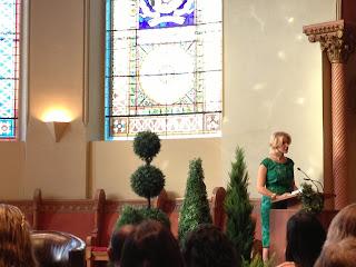 Elizabeth Gilbert reading at the podium