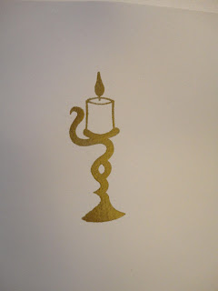 Candle image embossed in gold