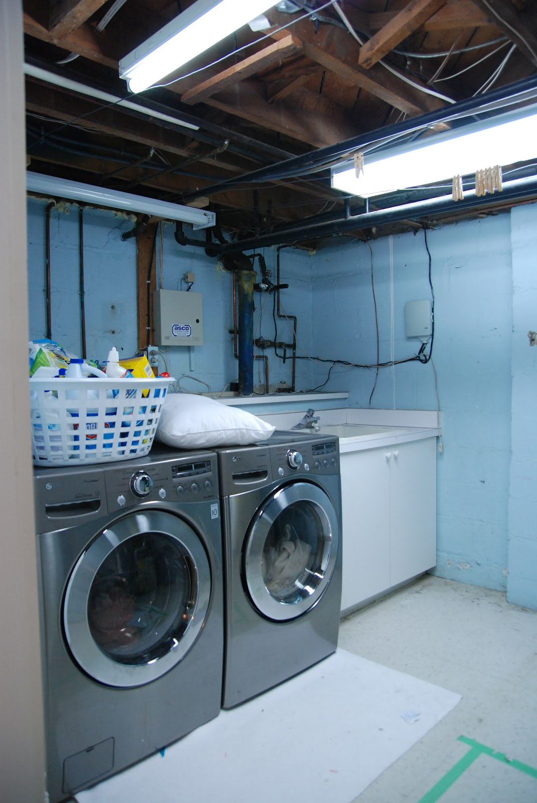 unfinished basement laundry room makeover pretty typical for a laundry