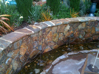 Green Acres retaining wall with rill