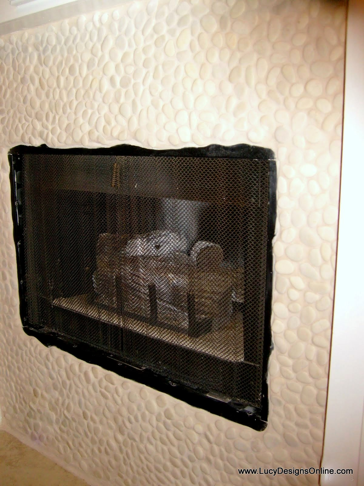 fireplace surround makeover using pebble mosaic tiles