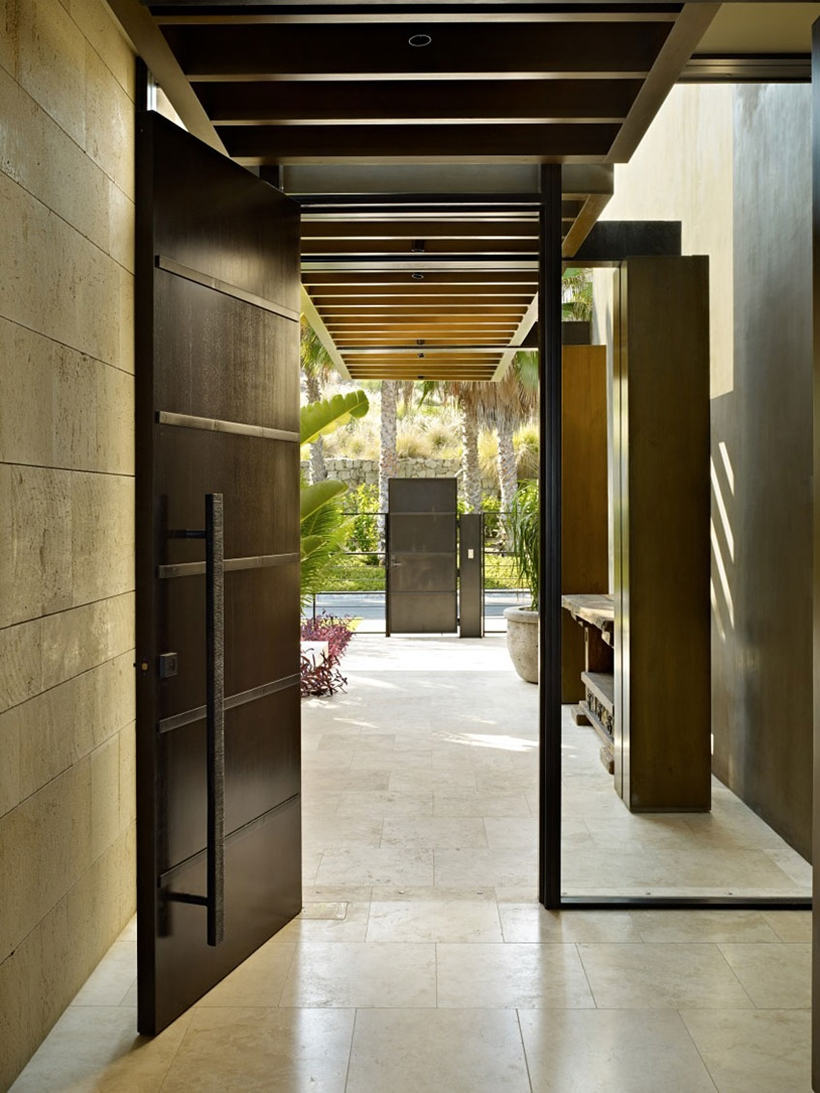 Entrance doors of the Gorgeous modern stone house on the beach