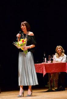Io, vincitrice di un premio letterario