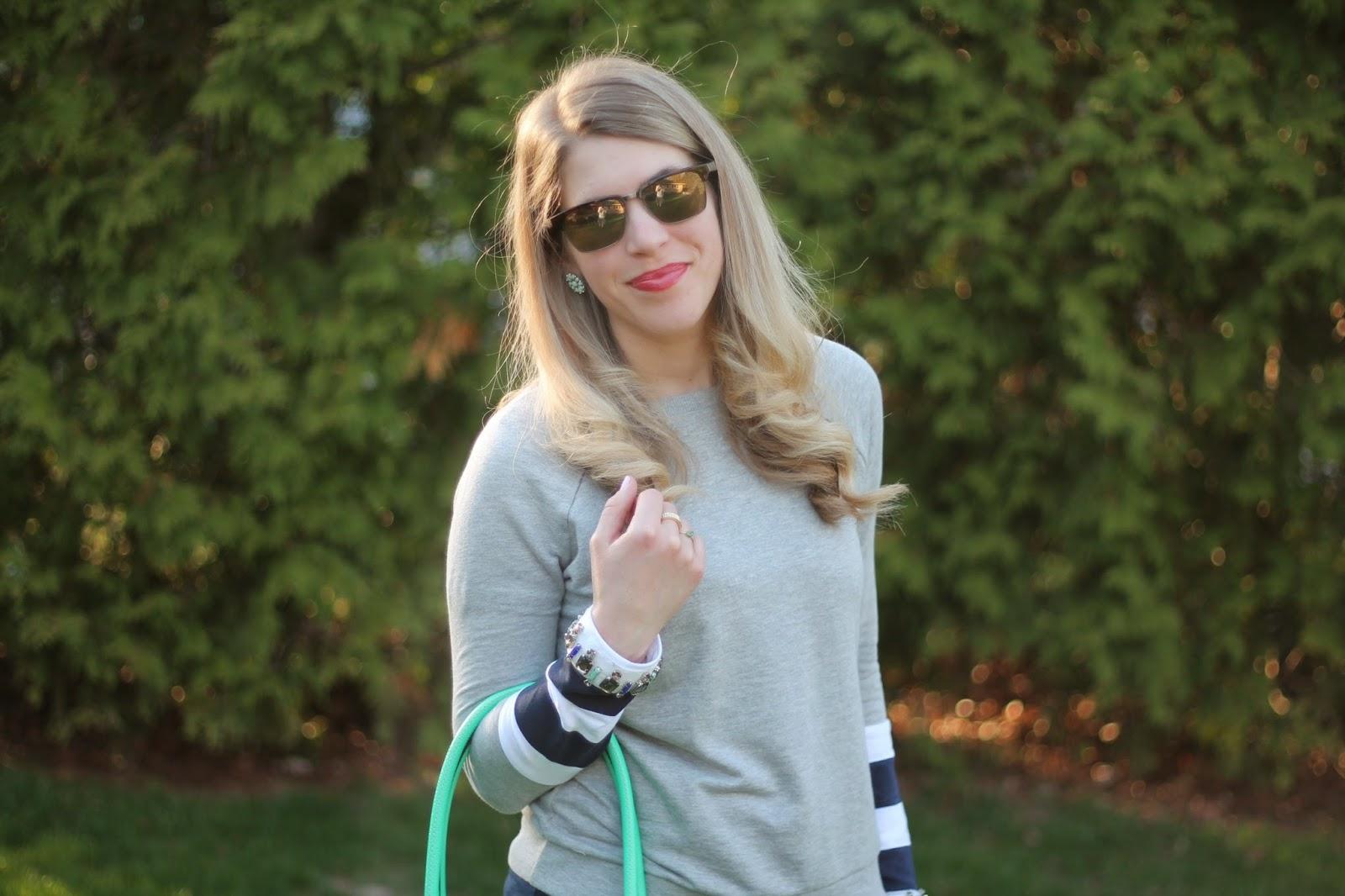 jewel embellished grey sweatshirt, green jeans, striped flats, mint kate spade bag