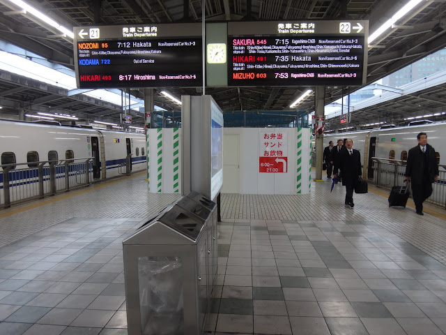 Waiting for Shinkansen to Hiroshima at Osaka (Shin-Osaka Station) train station in Japan