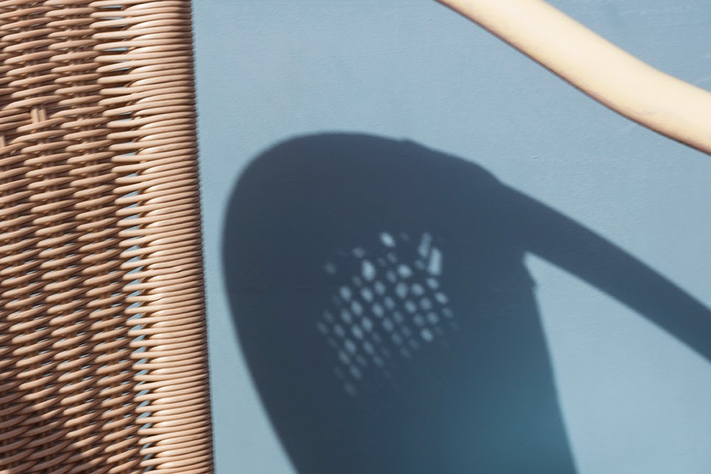 wicker chair and its shadow