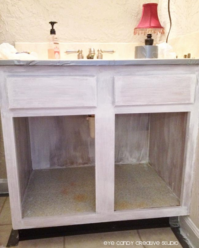 step by step to repainting bathroom cabinets, priming bathroom cabinets