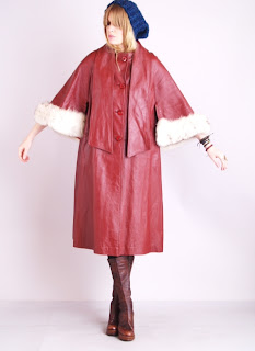 Vintage 1970's red leather coat with bracelet sleeves and white fox fur cuffs.