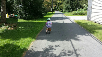 "Biking home from preschool via ""the squeeze-thru"" Friday, August 28, 2015"
