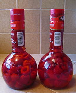 Two Bottles of Red Vinegar with Raspberries