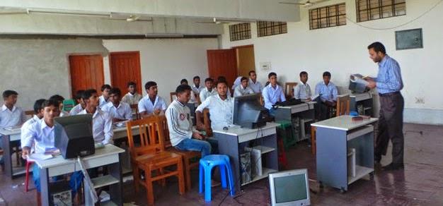 Professor Rezaul Karim teaches the fellow students