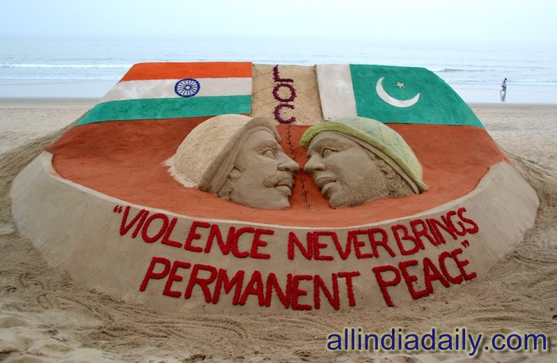 A sand sculpture on the Indo-Pak issue with a message Violence Never Brings Permanent Peace at Puri beach by Sudarsan Pattnaik