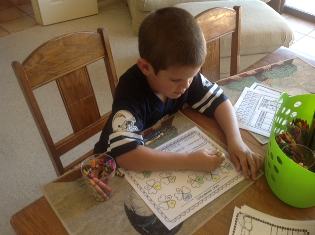 Grandson working on print outs.
