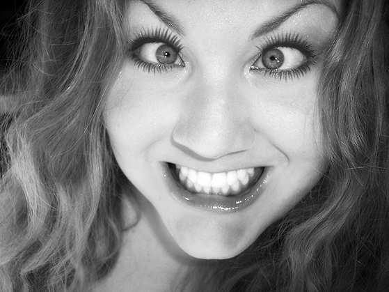 A young woman pulling a funny face