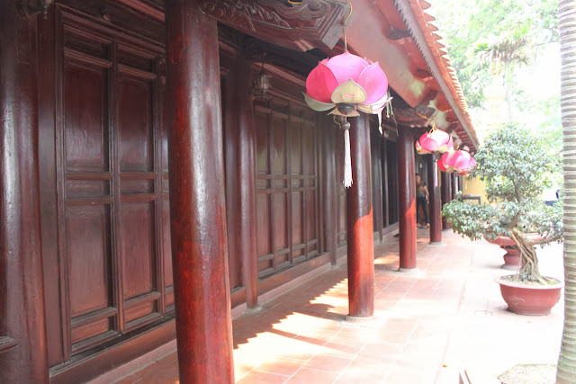 The side view of Buddhist red temple with Lotus lanterns at Tran Quoc Pagoda in Hanoi, Vietnami, Vietnam