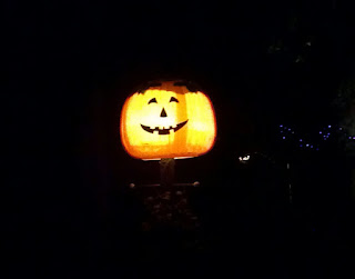 pumpkin cover on a lamppost at night