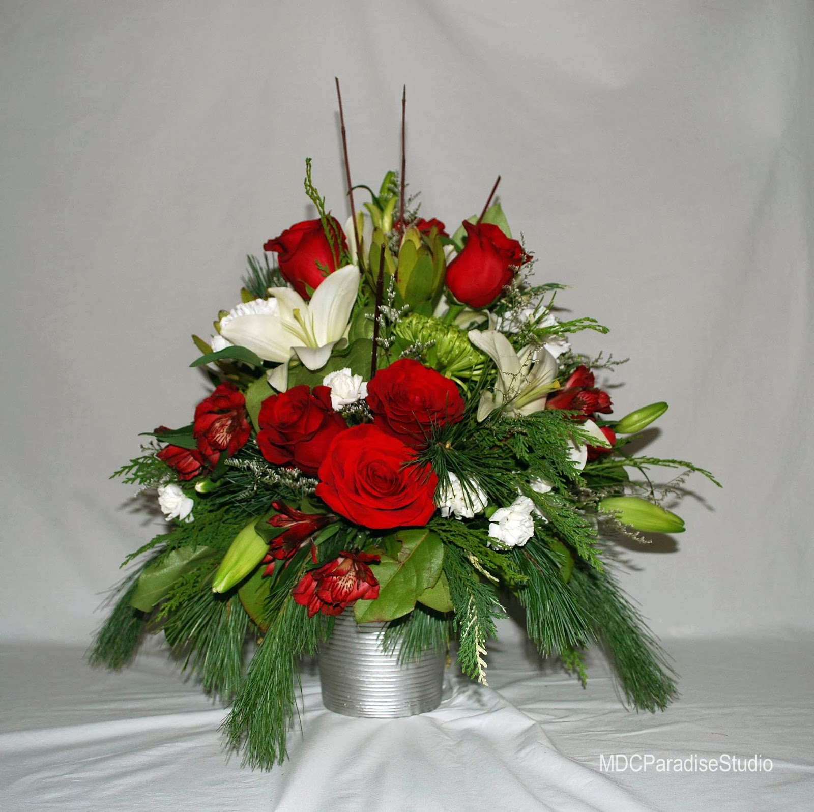 Paradise floral studio christmas flower arrangements for Poinsettia arrangements