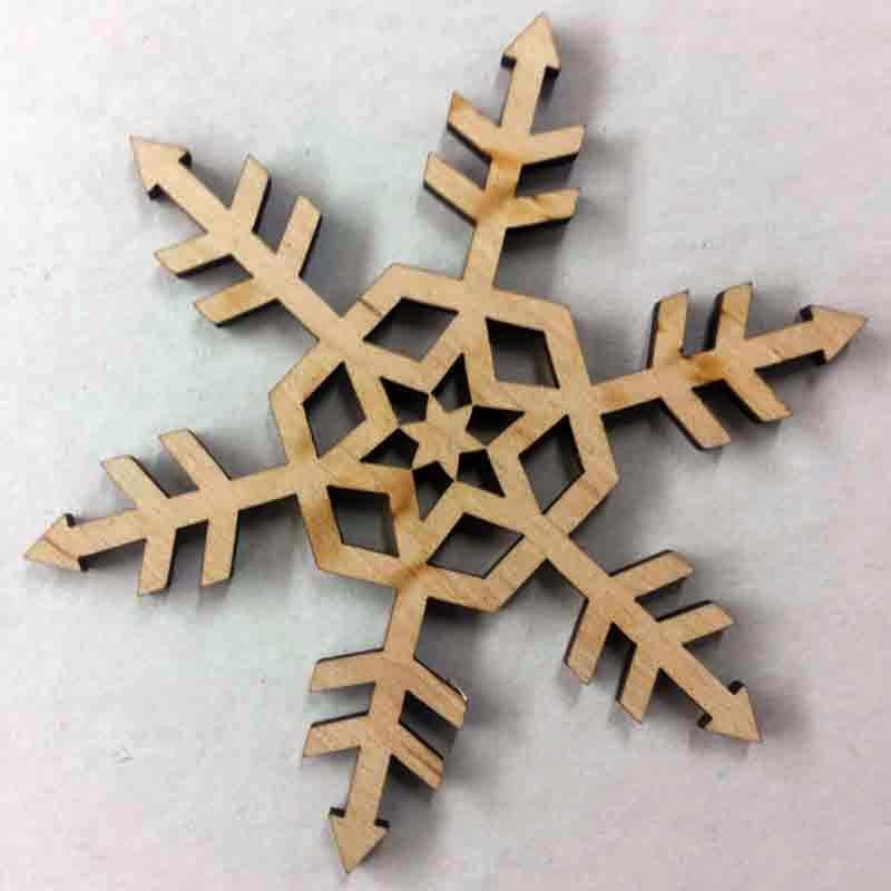 Лазерная резка снежинка из фанеры