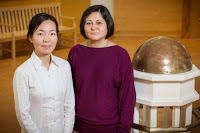 A new study co-written by Madhu Khanna, right, a professor of agricultural and consumer economics at Illinois, and Weiwei Wang, a postdoctoral research associate at Illinois, found that harvesting wood pellets in the US and exporting them to the EU was more environmentally friendly than burning coal in the EU to generate electricity. (Credit: Photo by L. Brian Stauffer) Click to Enlarge.