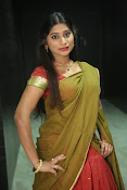 Midhuna latest sizzling pics in half saree-thumbnail-6