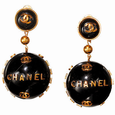 Vintage designer Chanel earrings with logo in gold