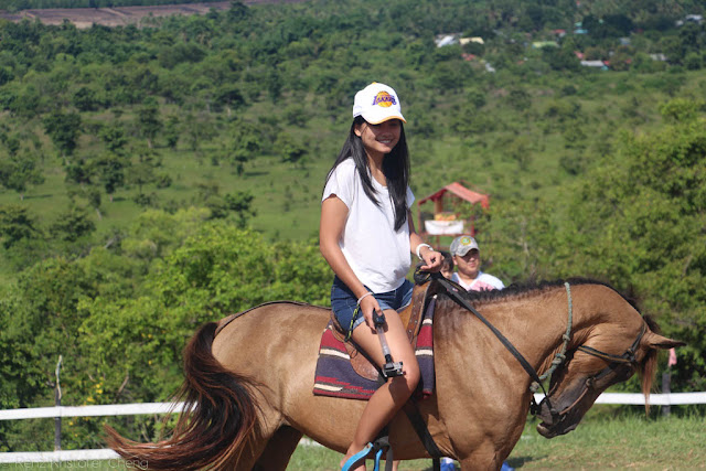 Andrea Gonzales riding a horse in Palawan - Mitra's Ranch