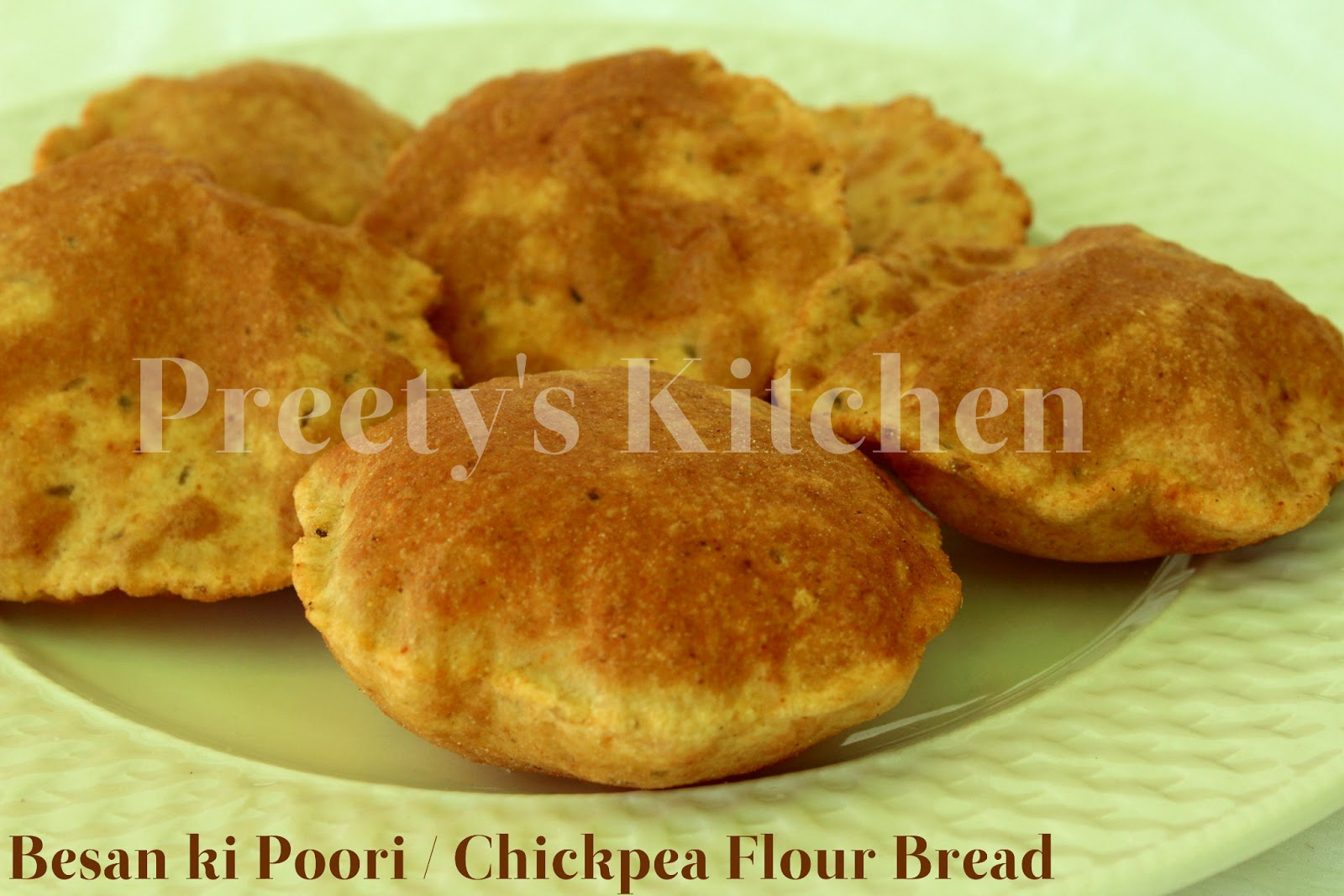 besan pooris are crispy deep fried puffed indian flat bread made with ...