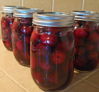 Jars of Canned Cherries in Honey Sauce