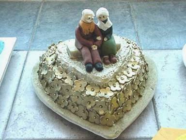 Noivos velhinhos para topo de bolo de bodas de ouro