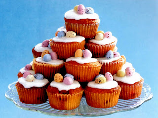 Small pyramid of decorated cupcakes with easter eggs for easter