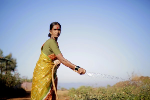 With a mutual understanding of sharing the labor and produce, families come together to set up Kitchen Gardens