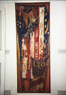 Before support and stabilization of historic flag, art conservation, small space display of large textile