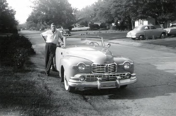 Posing with his Lincoln convertible