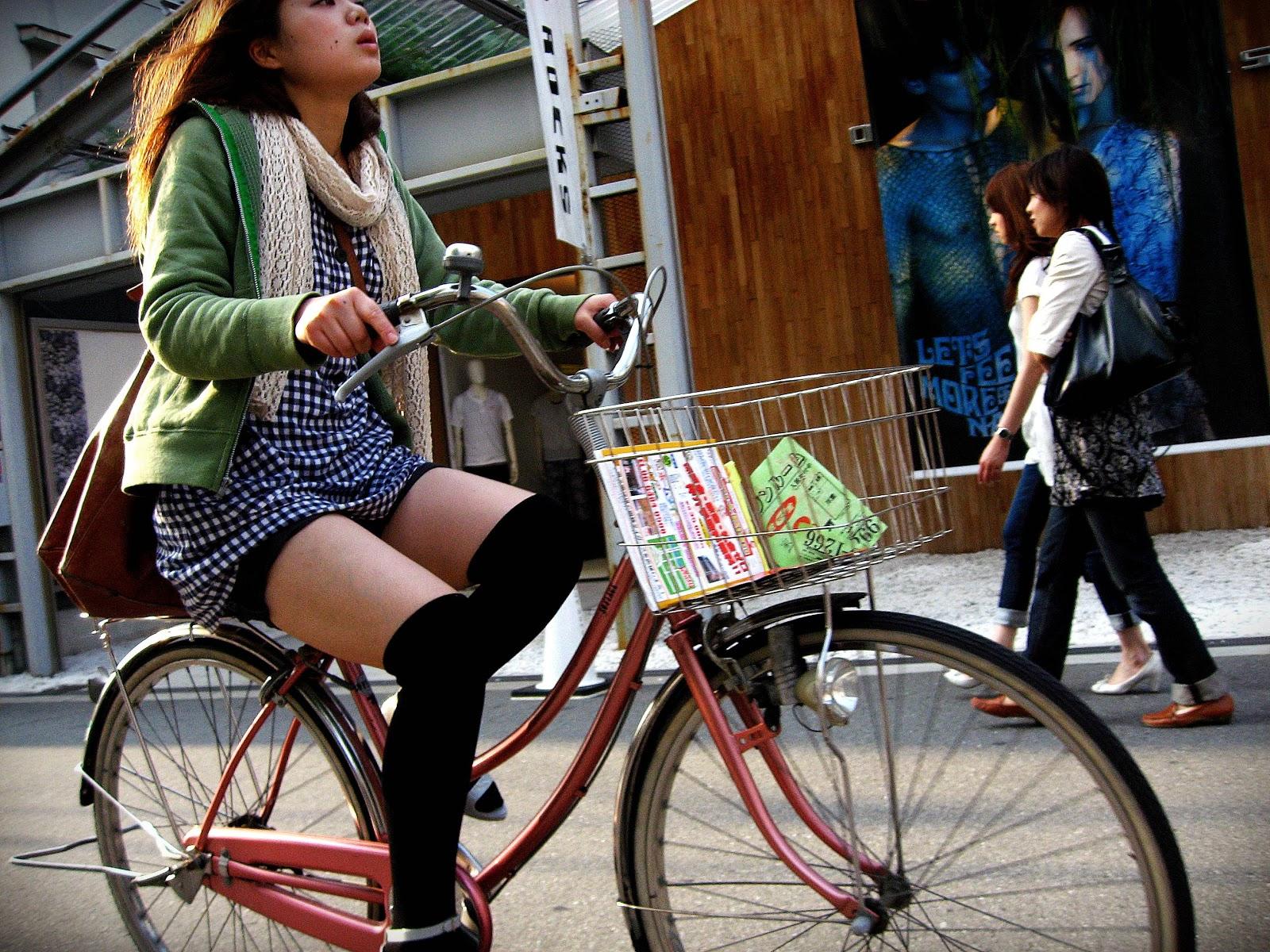 Cute Girl Riding Bike In Osaka