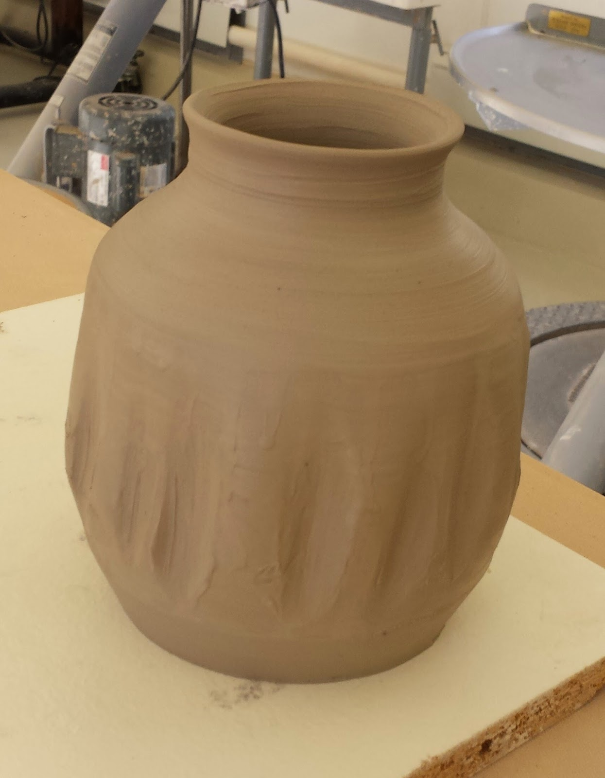 Stoneware clay pot in progress.