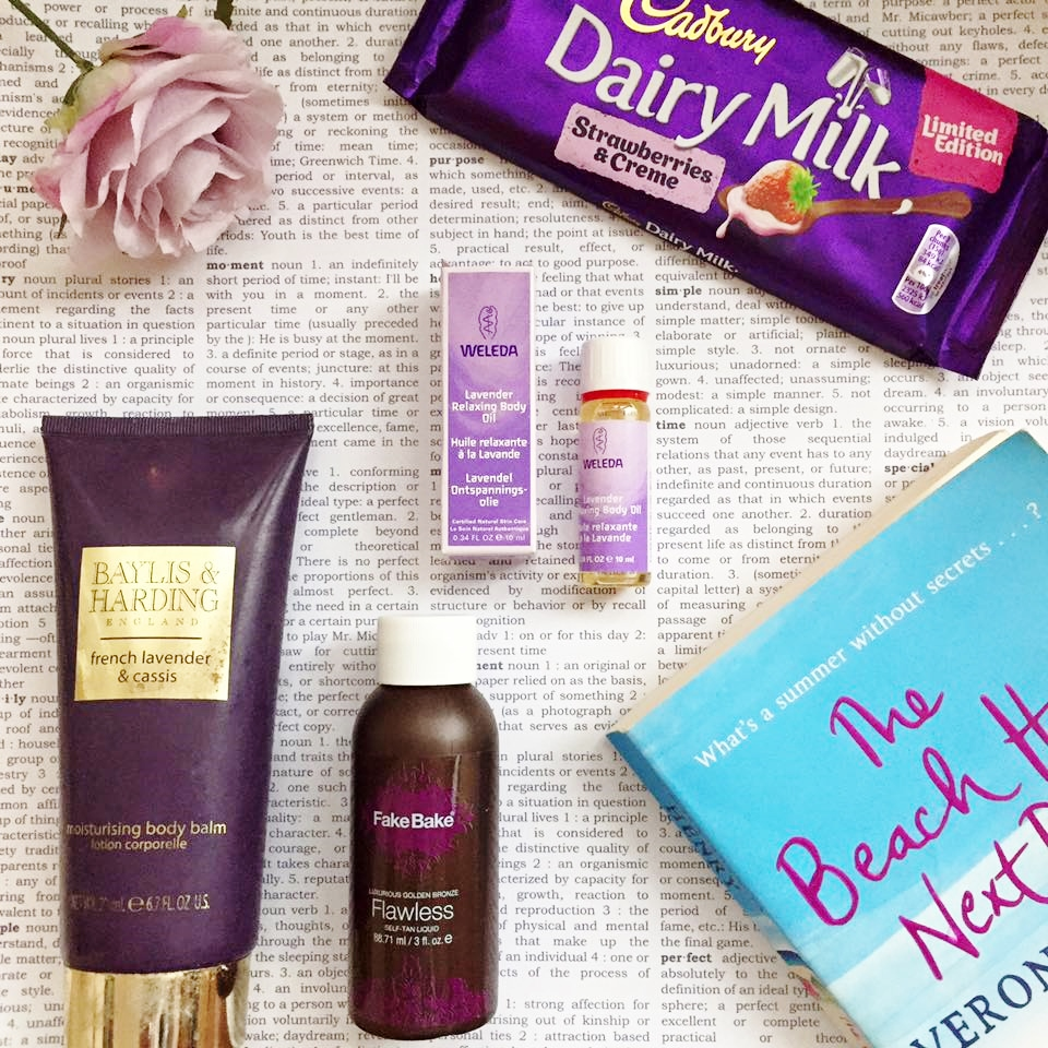 Creative flat lay featuring body lotion, chocolate and a reading book
