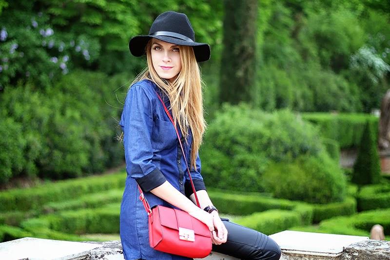 leather pants, denim shirt, red crossbody bag, fedora
