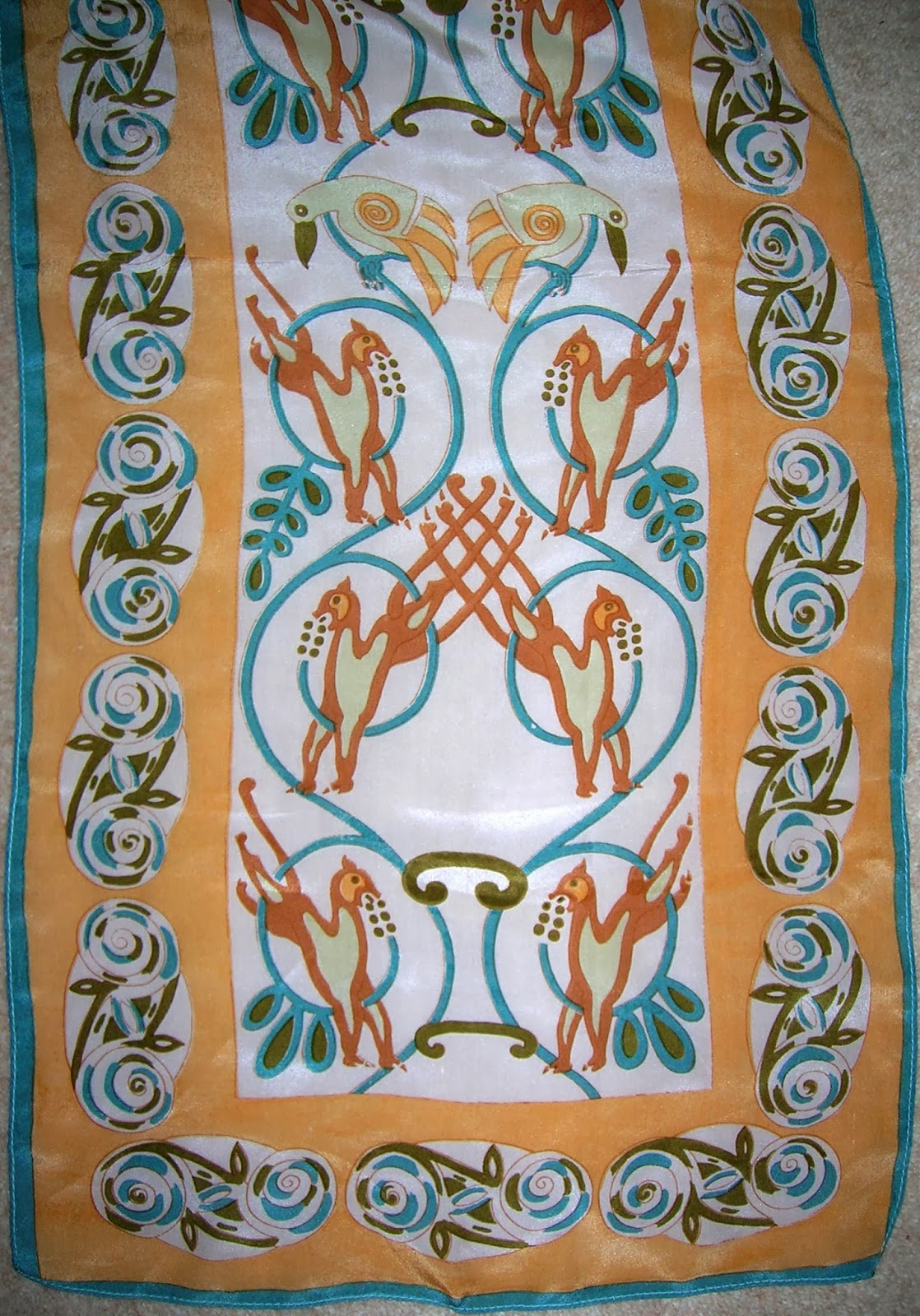 teal, butterscotch, orange and white celtic patterned scarf
