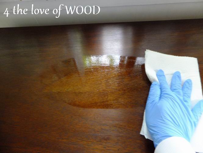 Wipe it from side to side covering the whole surface in a thin coat